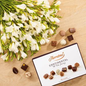 White Freesia Bouquet and Continental Chocolate Box tablet