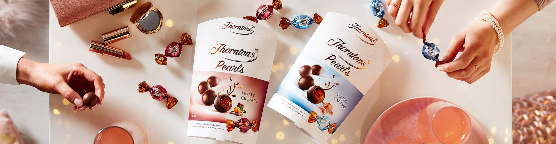 Introducing Thorntons Pearls, a chic treat made especially for sharing. Wrapped in a shell of our deliciously smooth milk chocolate, you'll find a surprisingly luxurious centre hidden inside. With Nutty Crunch and Gooey Caramel to choose from it's almost impossible to decide