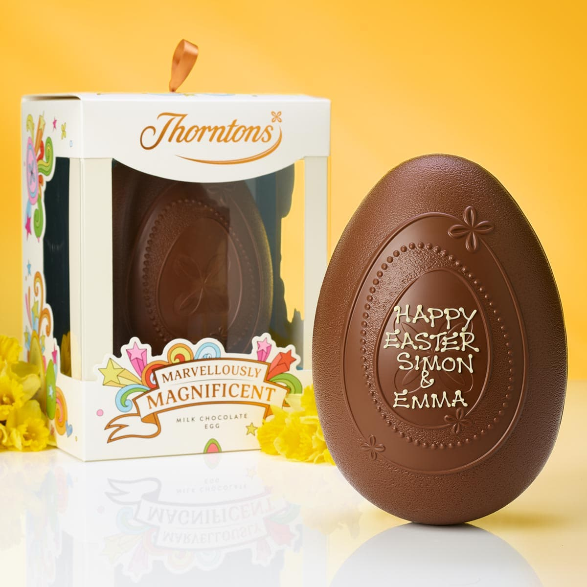 A personalised large Easter egg and plain large Easter egg in its box.