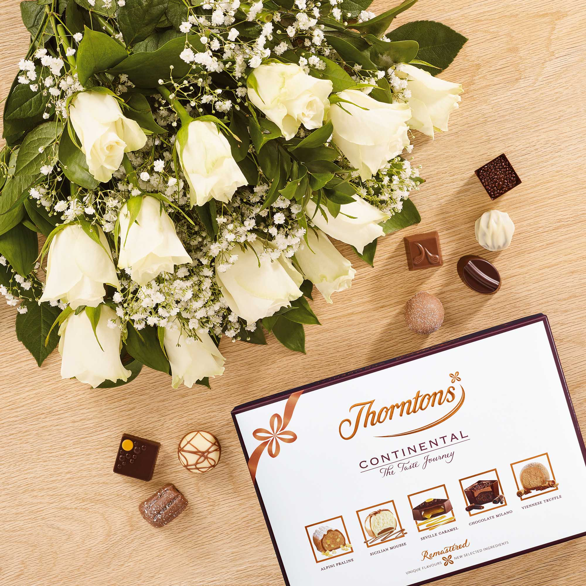Dozen white roses and 142g continental chocolate flowers thorntons images izmirmasajfo