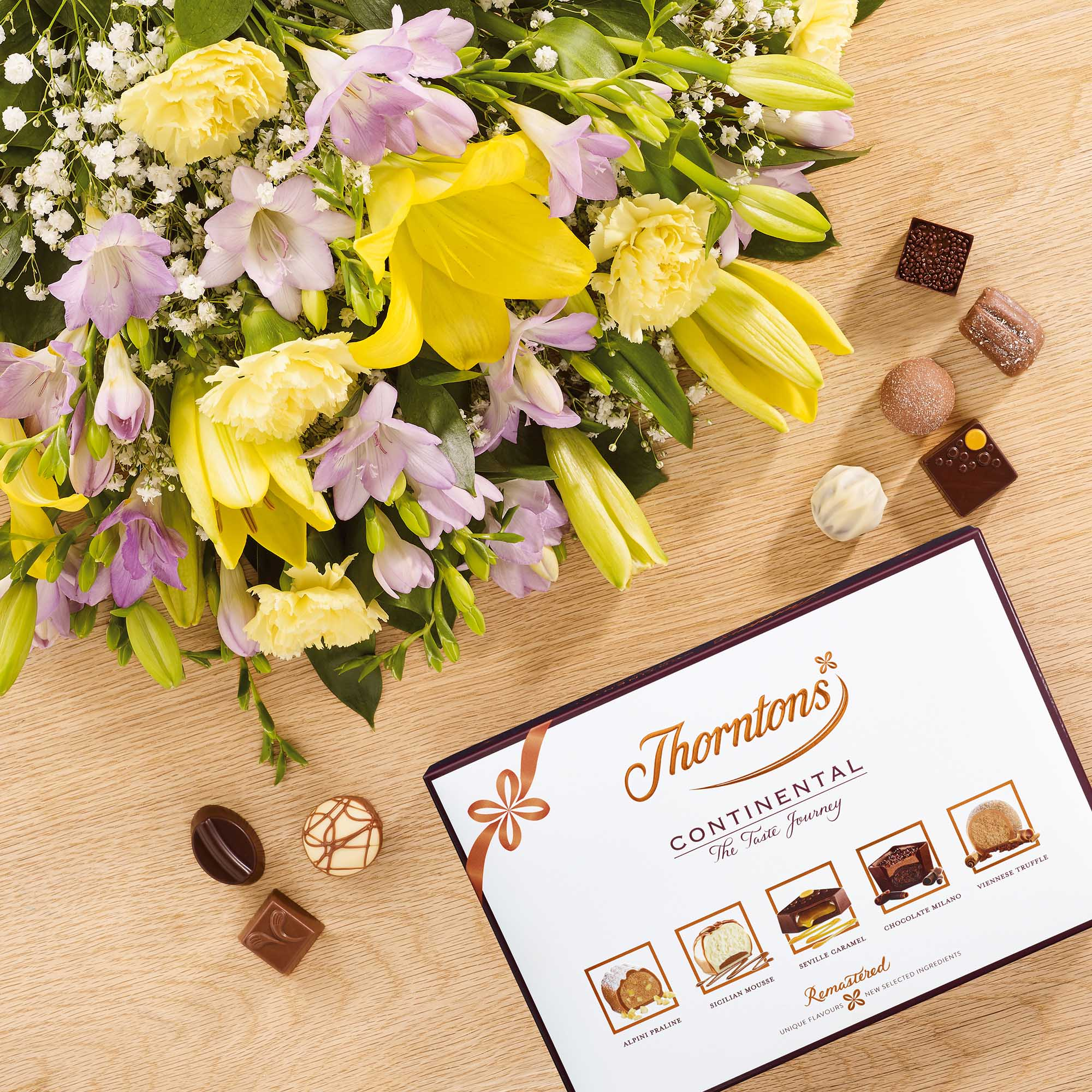 Lily and freesia with 142g continental chocolate flowers thorntons izmirmasajfo